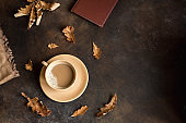 Cup of cocoa and autumn leaves