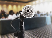 Microphone in front of defocused audience at business meeting