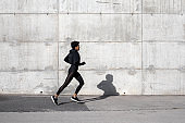 Young Woman Running on The Streets