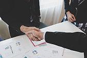 Asian Businessmen handshaking after successful business meeting. goals, business deals concept