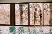 Loving couple relaxing in the spa by the pool
