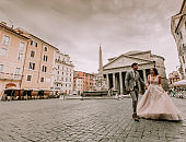 Young wedding couple by the Pantheon in Rome, Italy