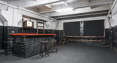 Black Brick Bar Counter with Wooden Desk. Loft Studio Interior