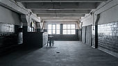 Loft Style Studio with Black Brick Walls with Bar Counter