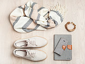 women's flat lay clothes shoes, scarf, bracelet, bag, tablet, smartlphone. Fashion blog, clothing, shopping,