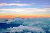 Majestic mountains sunrise with ground covered by clouds
