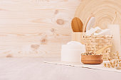 Rustic white homemade cosmetics set of naturel products for body care and bath accessories with spikelets in light beige wood interior, copy space.
