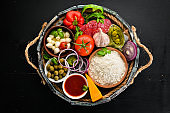 Ingredients for pizza in a wooden box. Top view. On a wooden background. Free copy space.