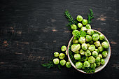 Fresh Brussels cabbage on a black background. Vegetables. Top view. Free space for your text.