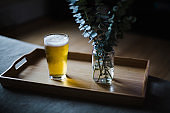 Glass of beer on a tray