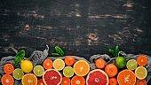 A set of citrus fruit. Orange, tangerine, grapefruit, lemon. On a wooden background. Top view. Copy space.