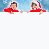 Children kids girl boy Christmas Santa Claus pointing happy empty banner copyspace copy space
