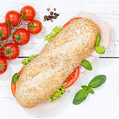 Sub sandwich whole grain grains baguette with ham square