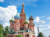 Domes of Saint Basil Cathedral on blue sky background. Monument to Minin and Pozharsky. Famous landmark of Moscow, Russia.