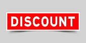 Square red color sticker with word discount on gray background