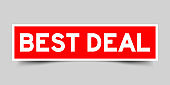 Red sticker with word best deal on gray background
