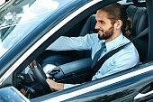 Man Driving Car. Portrait Of Smiling Male Driving Car