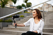 Blogging. Woman Filming Video On Camera On Street