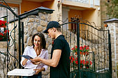 Courier Delivering Food To Client Home. Pizza Delivery