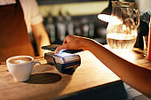 Paying With Mobile Phone In Cafe