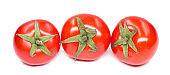 Fresh cherry tomatoes on white background.