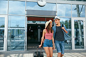 Travel. Happy Couple Near Airport, Traveling On Vacations