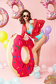 Summer Fashion. Woman In Swimsuit With Balloons