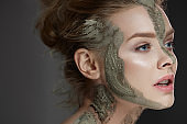 Beauty Treatment. Woman With Cosmetic Clay Mask On Skin