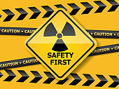 radiation warning sign on yellow wall vector background