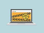 website under construction on laptop