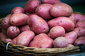 Raw potatoes in baskets on the market