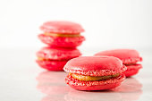 French dessert macaroons with pistachios and strawberries. White background