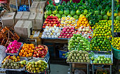 Fruit shops in the market with all kinds like: tangerines. pomegranate, orange, apple, pear, grape, mango, dragon fruit, lychee ...