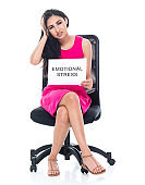 Attractive latino female sitting and feeling emotional stress