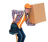Construction worker holding cardboard box with backpain