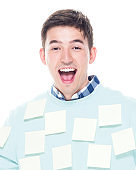 Attractive man covered in adhesive notes and is excited
