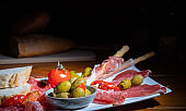 Antipasto on a plate with wine and bread