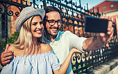 Happy couple making a selfie with mobile phone. Dating, love, relationships, lifestyle concept