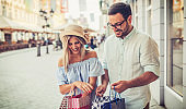 Young couple in shopping. Consumerism, love, dating, lifestyle concept