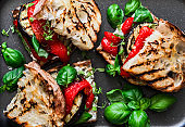Grilled eggplant, pepper, ciabatta bread sandwiches - healthy summer snack. Picnic food, top view