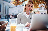 Business woman on coffee break in a cafe. Business, education, lifestyle concept