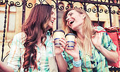 Shopping time. Beautiful women take a coffee break after shopping. Consumerism, shopping, lifestyle concept