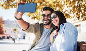 Young smiling couple taking a selfie with smartphone. Dating, love and tenderness, relationships, fashion, lifestyle concept