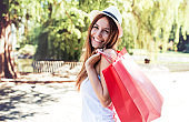 Shopping time. Young woman in shopping. Consumerism, shopping, lifestyle concept