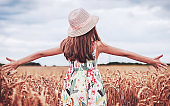 Childhood time. Happy little girl in the wheat field. Childhood, lifestyle concept