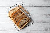 slices raisin bread on wooden board