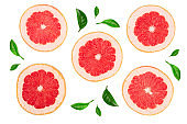 Grapefruit slices with leaf isolated on white background. Top view. Flat lay pattern