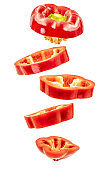 flying red bell pepper slices isolated on white background with clipping path