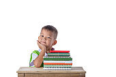 portrait of smiling little student asian boy with many books education and school concept isolated on white background