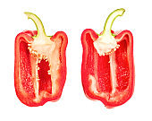 red bell pepper halves isolated on white background with clipping path